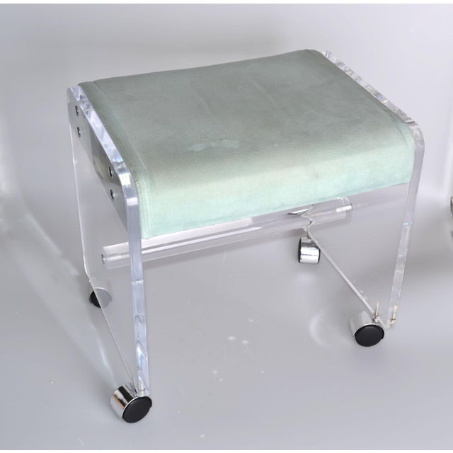 Gorgeous mid-century modern Lucite stool on casters with mint velvet upholstery. Can be used as vanity stool or just as...