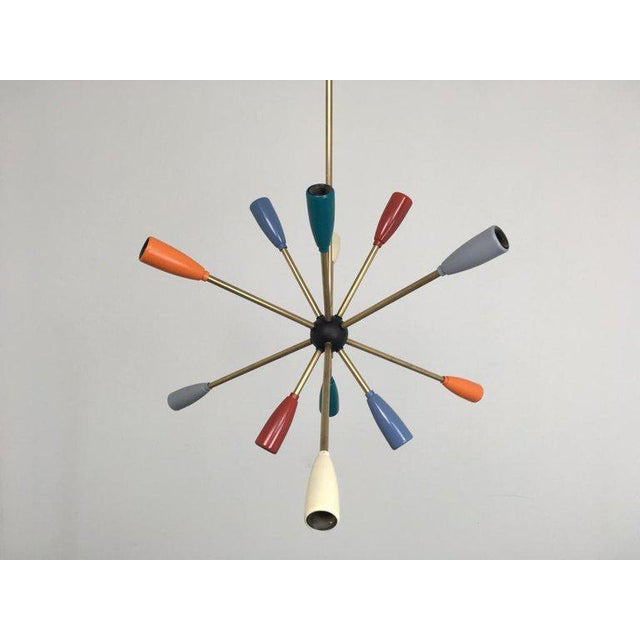 1950s Sputnik lamp in different colors. 12 x E14 bulbs. Wiring is in good condition, but should still be checked by a...