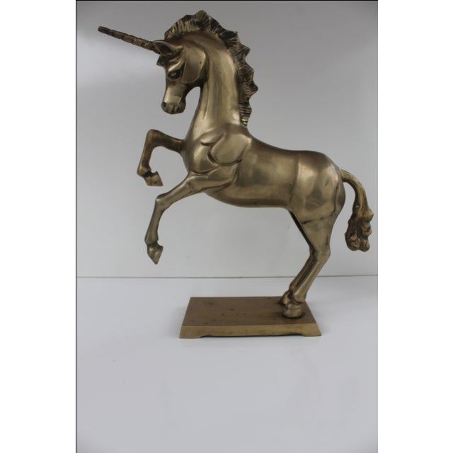 1970s vintage Hollywood regency solid brass unicorn/horse decorative sculpture. Excellent condition. This neat piece is...