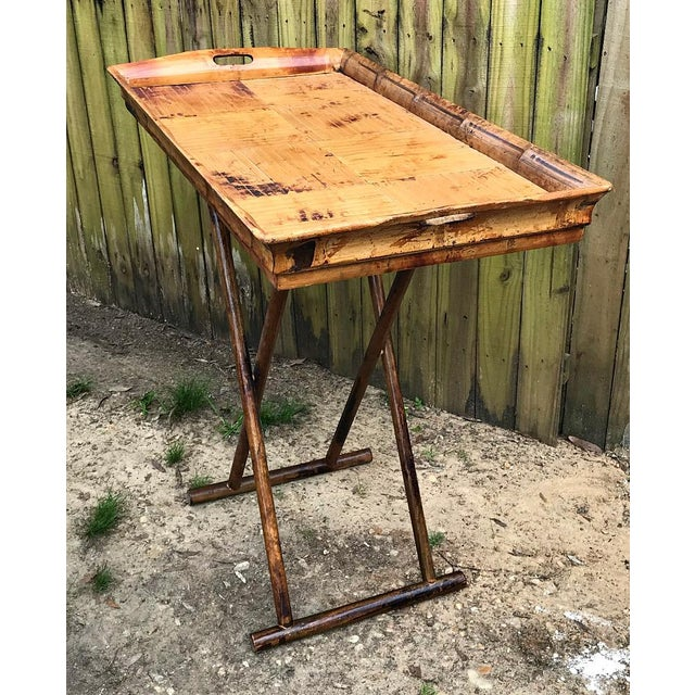 Extra large bamboo serving tray table with folding base. Very heavy and solid. Large folding wood base. No stains holes or...