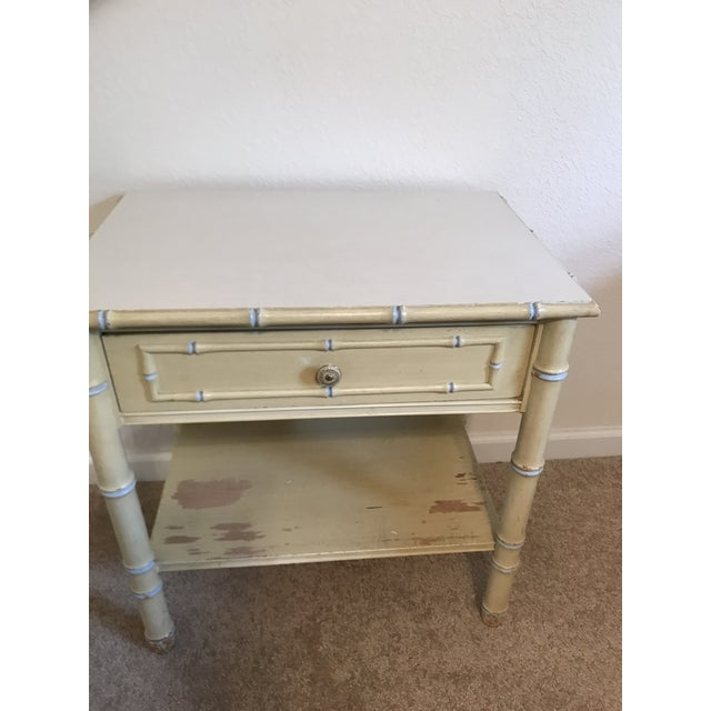Thomasville Faux bamboo nightstand in original yellow paint with white top. Made in the 1960s.