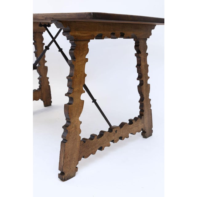18th century Spanish table: Swietenia mahogany top (Cuban mahogany) raised upon thick hand-carved quarter-sawn shaped...