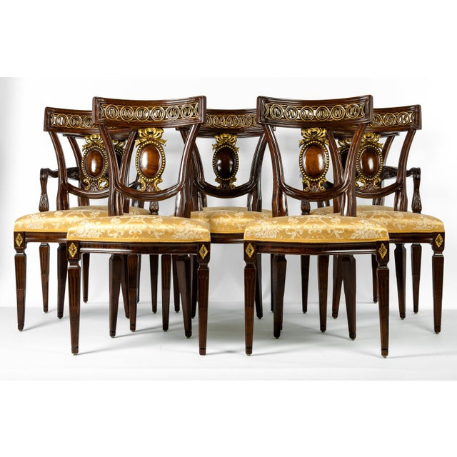 A vintage set of eight European mahogany wood dining chairs. Six side chairs and two armchairs. These chairs are...