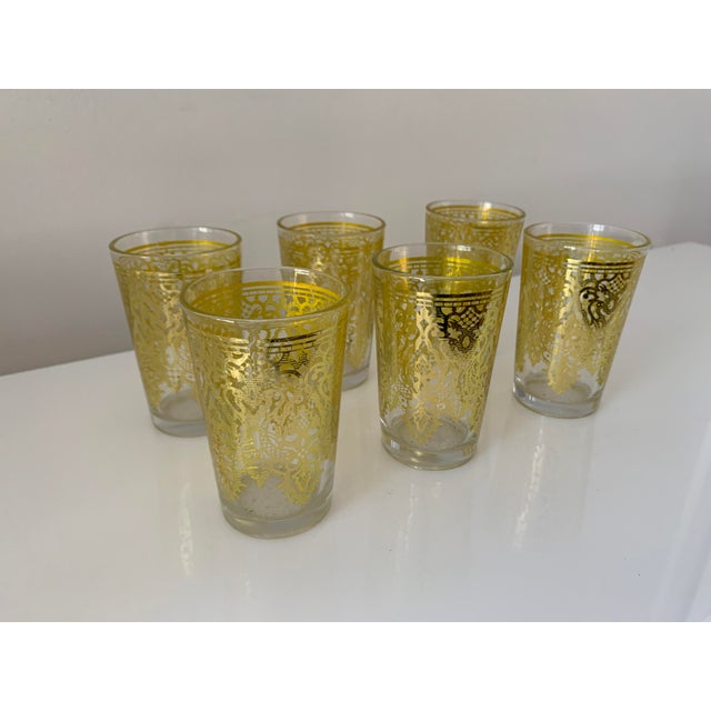 Imported from Israel, six Moroccan tea glasses with gold motifs. Great for serving tea or wine. This attractive set makes...
