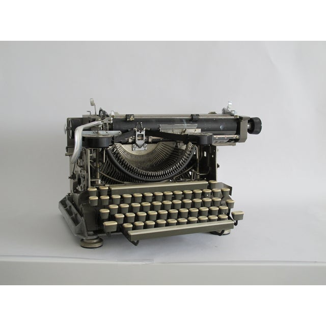 "1920s typewriter in the ""blind"" writing style with an exposed tape. Keys still function properly, typewriter may function..."