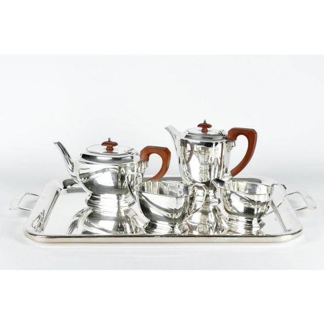 Exquisite quality English Art Deco silver plated four piece tea or coffee service. Each piece in excellent condition. The...