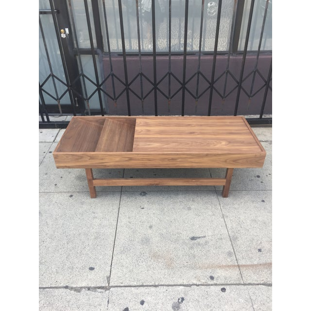 Handcrafted in Los Angeles this solid walnut and walnut veneer coffee table is clean and minimal. Made with a mid century...