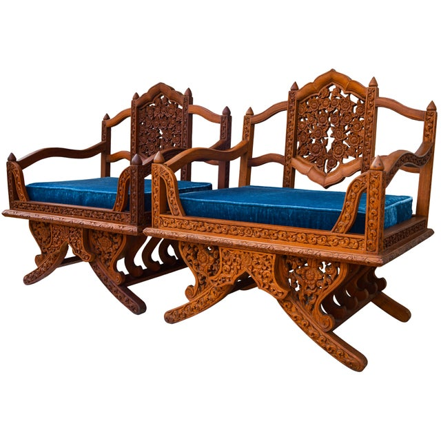 A rare Anglo-Indian elephant saddle-seat chairs. Made of handcarved rosewood with intricate floral pattern, ornate base...