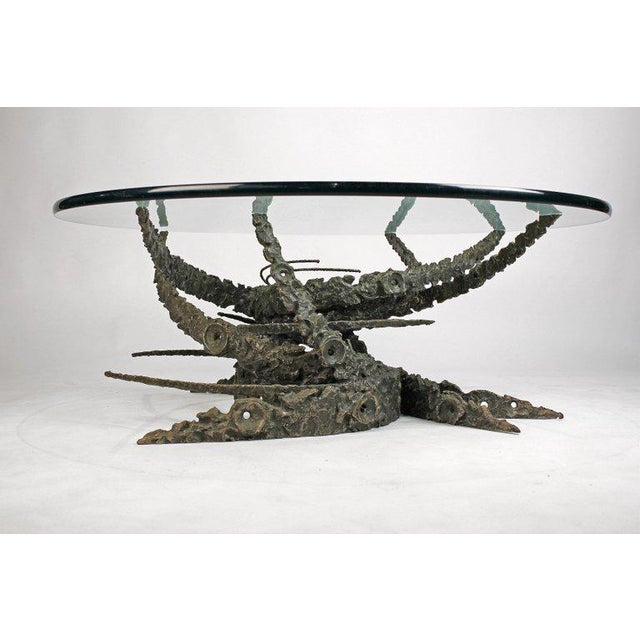 Early and rare Daniel Gluck table from his 'swirl' series. Sculpted solid cast bronze base with circular glass top. There...
