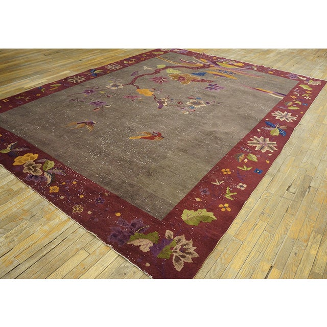 Antique Chinese Art Deco Rug with an ivory background and patterned border.