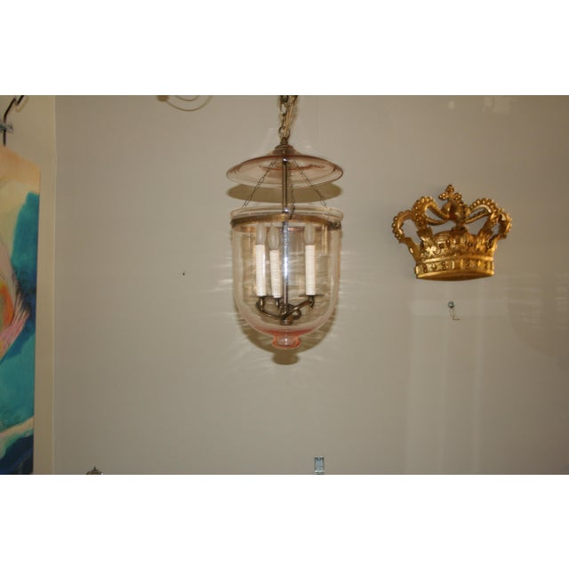 The pink tint to the glass jar and smoke lid will give your ceiling a soft warm look and not over the top. The jar is...