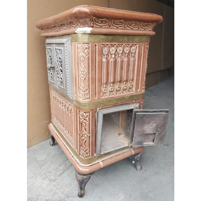 A stunning French majolica faïencerie (earthenware) tiled antique heating stove by Sarreguemines - Digoin - Vitry-le-...