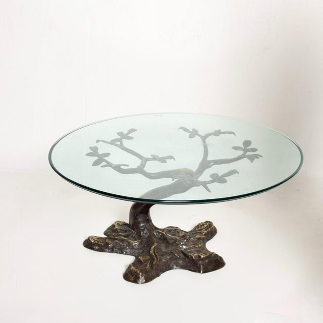 We are pleased to offer for your consideration a beautiful bronze coffee table designed by Willy Daro. Beautiful bonsai...