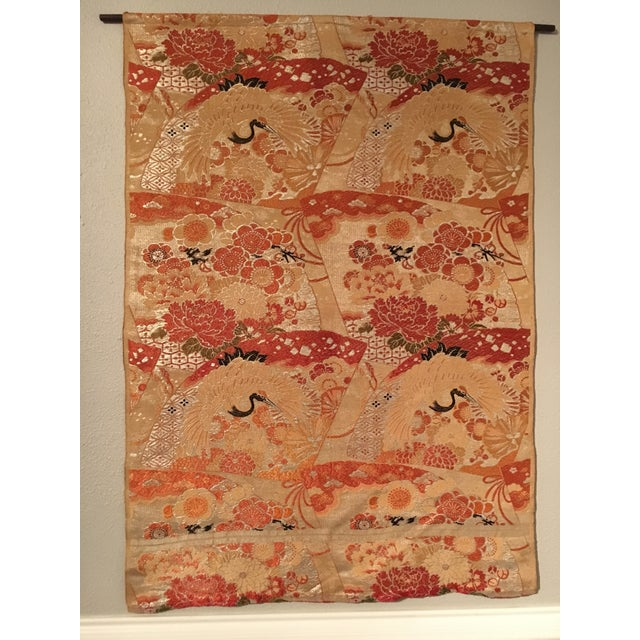 This is a beautiful vintage silk wall tapestry. It features silver metallic, tan, burnt orange, chocolate brown, and black...