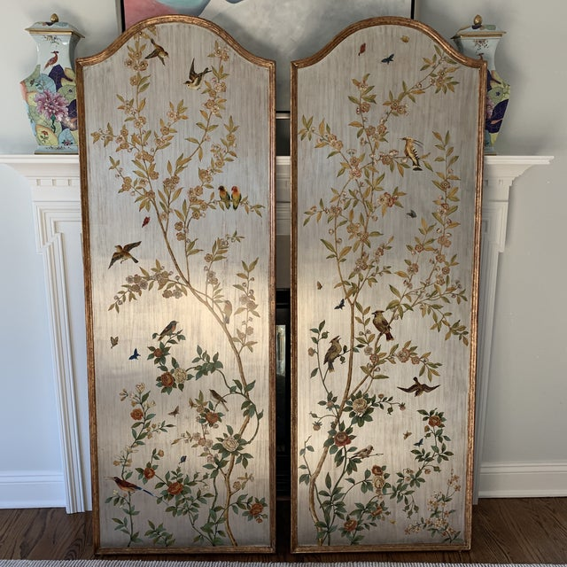 Gorgeous pair of hand painted chinoiserie wall panels. Birds, trees, flowers and foliage adorn two over sized...