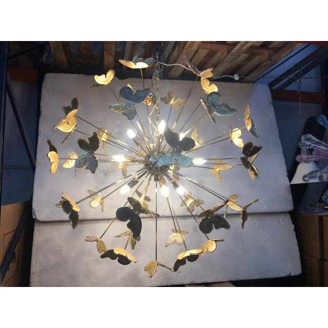 This is a unique and Rare Gold 24 karat Metal frame Chandelier sputnik chandelier with leaf gold 24 karat butterfly Murano...