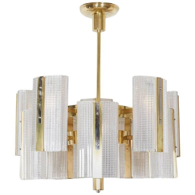 Very large Art Moderne highly architectural ten-arm chandelier comprising bi level rectangular boxes of interlacing lines...