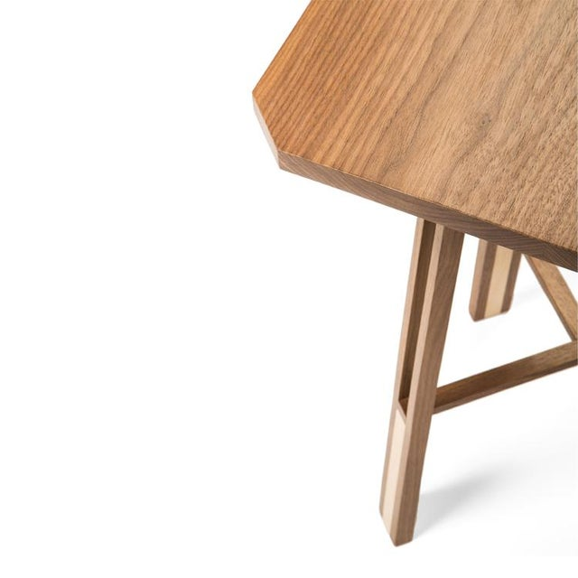 The Honeycomb table is a beautiful balance between dark, rich walnut and maple highlights of pale honey gold. The...