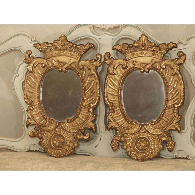 Pair of Italian Gilt Wood Carved Mirrors.