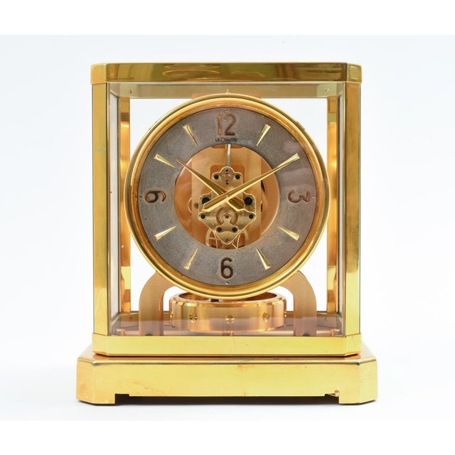 Atmos glass with brass covered case desk / table clock. The table / desk clock is in excellent vintage working condition,...