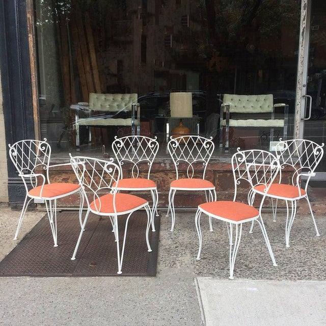 Set of six, mid century, patio, garden, outdoor, dining chairs feature scrolled, wrought iron frames that are newly...