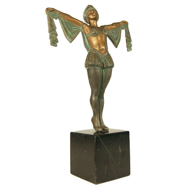 Vintage late 1920s Art Deco statue featuring a flapper dancer caste in Spelter with hand-painted green and bronze accents...