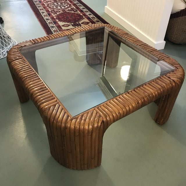 Nice vintage split rattan coffee table with glass inset. Square shape with curved waterfall edges. Some scratches to the...