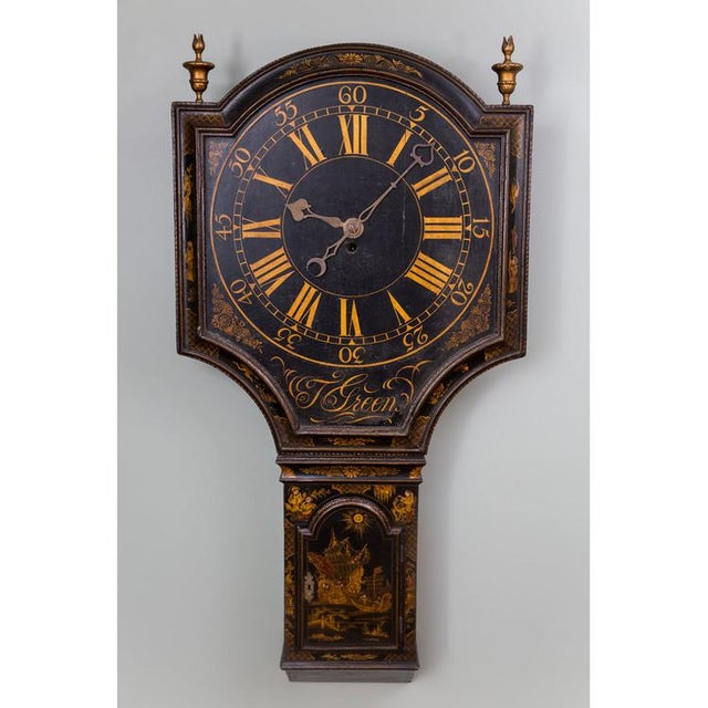 A fine Chinoiserie decorated japanned dial, or tavern, clock with a large shield-shaped dial having Roman and Arabic...