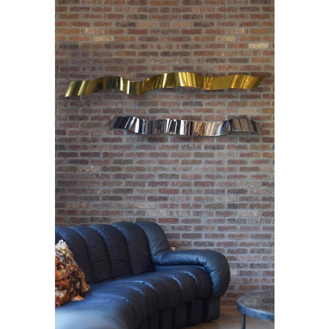 "A monumental pair of Silas Seandel ""Ribbons"" of brass and chrome, one signed and dated. Sold together, the sinuous..."
