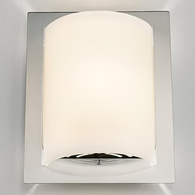 A brushed nickel and glass wall light. Certification: IP 20. Bulb: 2 X GU10 7W LED 2700K