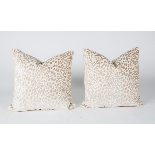 Pair of custom taupe-and-ivory velvet pillows with solid ivory linen cording. Cheetah pattern on fronts, solid ivory linen...