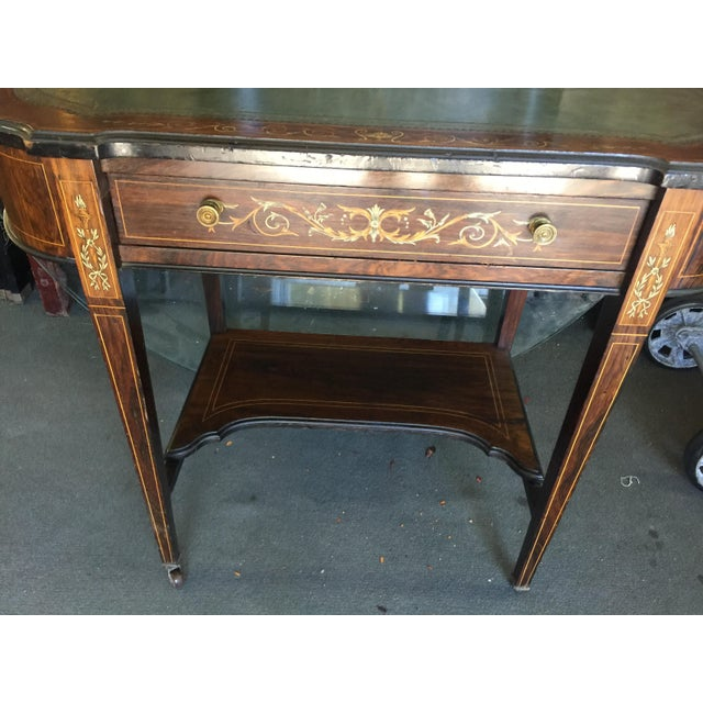 Petite Edwardian Inlaid desk with leather top. Beautiful wood and inlay. This does have some wear, the veneer has a couple...