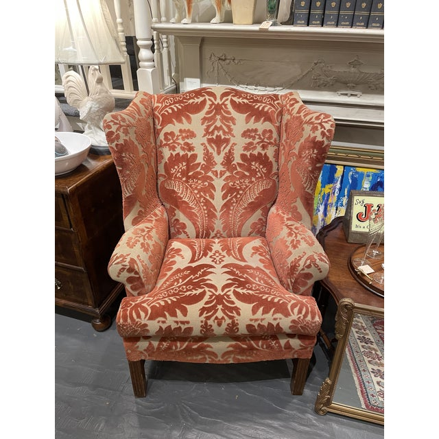 This gorgeous wingback is from the 1920's and in great condition. The Velvet Damask fabric has beautiful contrasting...