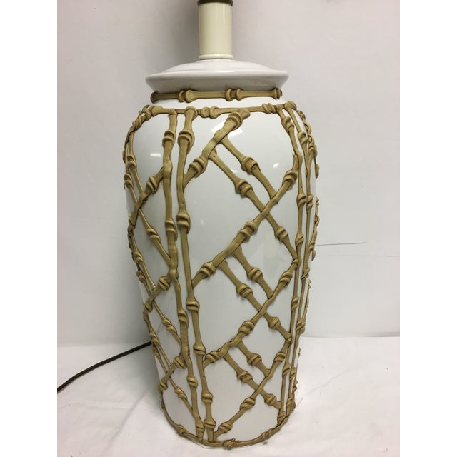 Vintage faux bamboo lamp from the 1970's . Out of prominent Detroit Estate. White ceramic with bamboo overlay . Excellent...