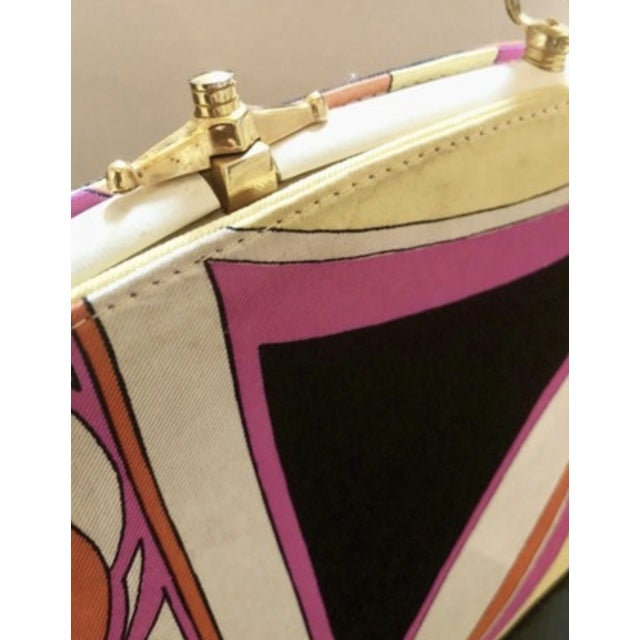 Iconic silk and leather 1960s purse by Jana for Emilio Pucci. Gorgeous black, white, pink and yellow pattern. Dimensions...