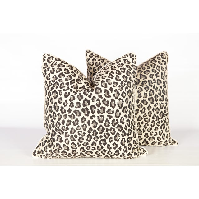 Pair of black, grey and white pillows with leopard pattern textile on front and back. Hidden zippers, ivory linen cording,...