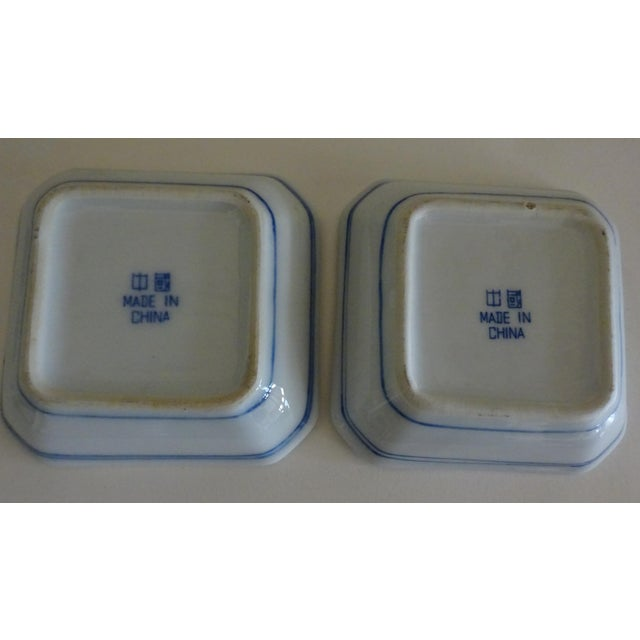 2 pretty little Sauce Dishes with center division for mustard and soy sauce. Stylized Canton style fitzhugh.