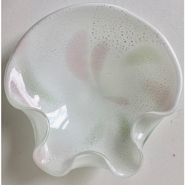 This lovely large hand-blown art glass bowl was made in Murano, Italy in the 1960's and features white cased glass with...