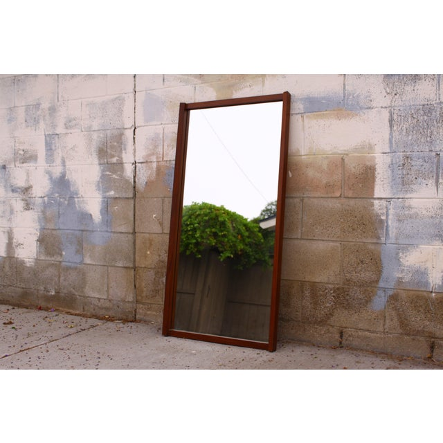 A beautiful large (roughly 4 feet tall) teak wall mirror, ready to be mounted. The stunning angular wood frame gives an...
