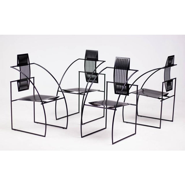 Set of four Quinta chairs by Italian architect Mario Botta. The Quinta chair is constructed with steel rod frame and...