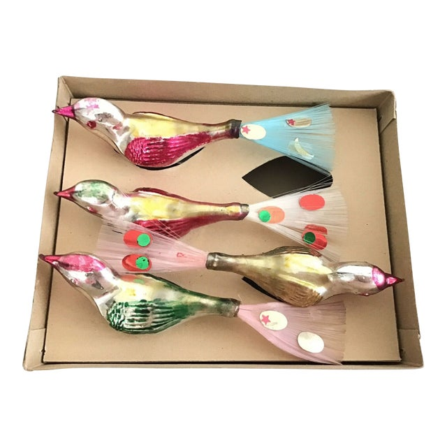 European hand-painted glass bird clip-on ornaments with accents in pink, green, fuchsia, and yellow on a shimmering...