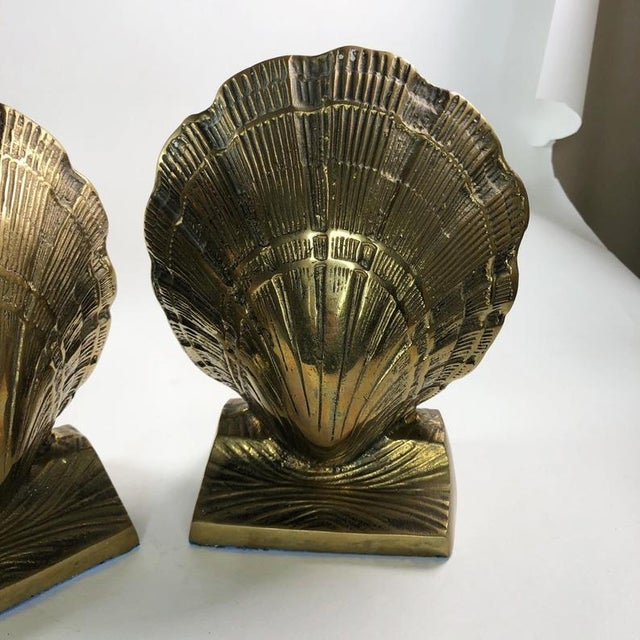 """Mid-Century Brass Clamshell Bookends 8"""" x 6"""" x 3.5"""" each Minor patina as seen in photos."""