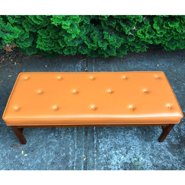 Beautiful walnut floating frame mid century modern bench circa 1960s. Very much in the style of the iconic Jens Risom....