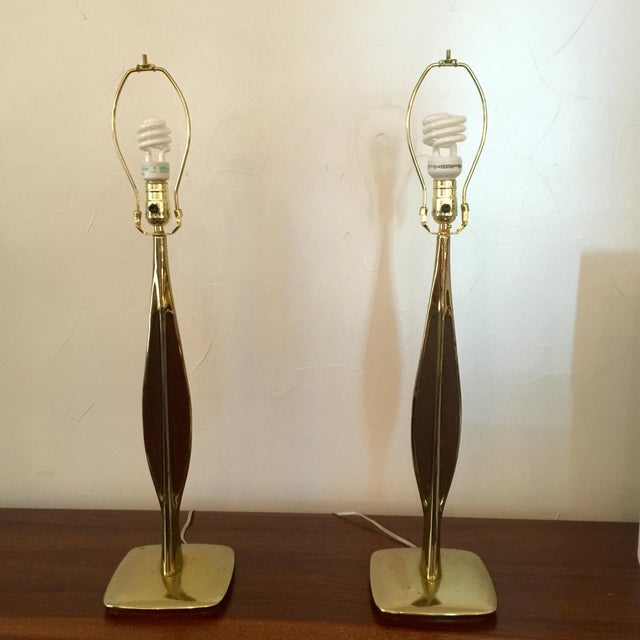 Completely rewired brass lamps with walnut inlays. Designed by the Laurel Lamp company. The pair is in excellent, vintage...