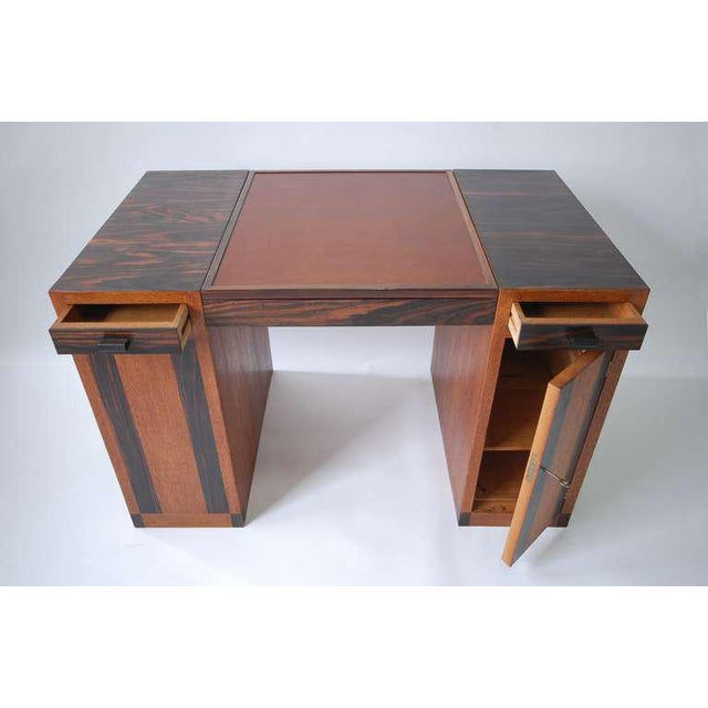 Game table or desk attributed Francis Jourdain, France, circa 1930. Fumed oak and palisander, with leather top. Center top...