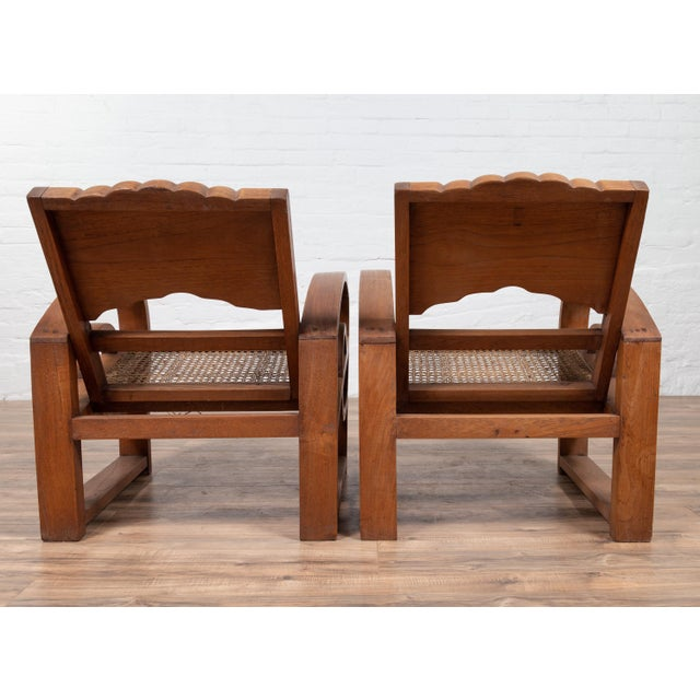 Teak Wood Country Chairs From Madura With Rattan Seats and Looping Arms - a Pair For Sale In New York - Image 6 of 13