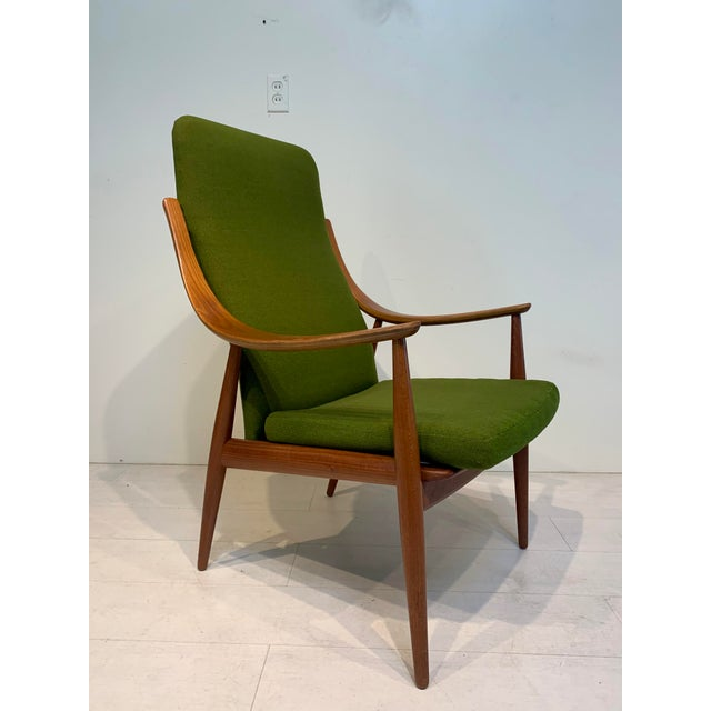 This stunning Mid Century Modern contoured lounge chair is by Peter Hvidt & Orla Mølgaard-Nielsen and imported by John...