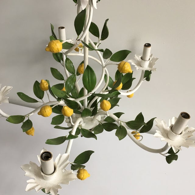 1960's Italian Tole painted lemon tree chandelier. Hand painted in white with green leaves and yellow lemons. Original...