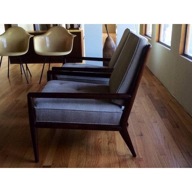 A pair of classic arm chairs by T.H.Robsjohn-Gibbings for Widdicomb. Timeless styling, long, elegant arms. Attached seat...