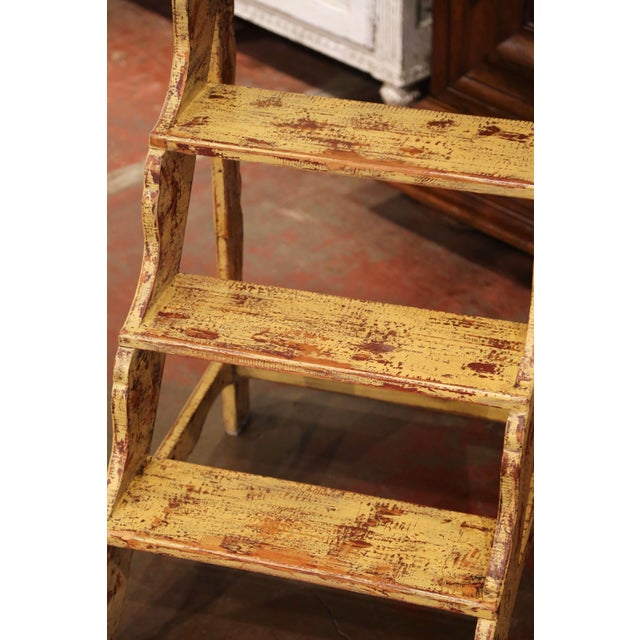 This elegant antique scalloped step ladder was created in France, circa 1970. Carved of pine, the ladder features four...